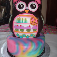 Hippy Chick   8th birthday cake based on the Hippie Chick line of party ware. Details on belly were cut with cricut cake machine