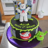 Ghost Busters Cake Made this for a friend.Vanilla cake with chocolate butter cream filling. My daughter helped with some of the figures.