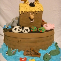 Dina's Baby Shower Cake My daughter Jenny's first paid cake.She made all the figures out of gum paste and in keeping with the Noah's Ark theme the cake...