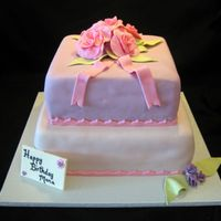 Birthday Cake This is a two tier fondant birthday cake with handmade gumpaste roses.