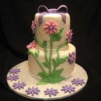 Blooming Birthday Cake This was a cake I created for a little girl's 7th birthday. She loves flowers and the colors pink and purple. The design was taken...
