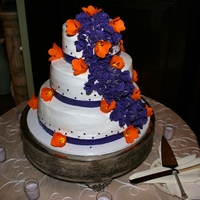 Wedding Cake With Cascading Flowers Amaretto cake with bavarian amaretto cream filling, almond icing buttercream. Flowers are lisanthius and tulips in ravens purple and...