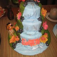Baby Luau Cake for luau themed shower.Fondant covered with fondant falls and boulders. Gumpaste flowers.