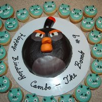 Bomb Bird Cake *Bomb Bird Cake with Pig cupcakes. Angry Birds. My son actually decorated this and I helped him. I did the cupcakes.