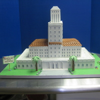 La City Hall  Cake made for couple married at city hall. Carrot cake with cream cheese filling/frostig. Panels are made from mexican gumpaste, dried, and...