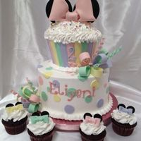 Minnie Mouse Inspired Cake. Buttercream with fondant decorations. Loopy bows and Minnie Mouse ears are made of gumpaste. Matching Minnie Mouse cupcakes.