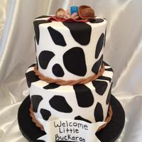 Western Themed Baby Shower Cake. Buttercream with fondant accents. Baby is laying on a fondant bandana with a fondant cowboy hat.