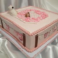 Baby Girl Cloth Line buttercream cake. baby, clothes and teddy bear are fondant