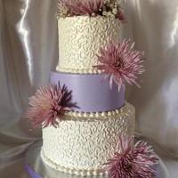 Lavender Cornelli Lace Wedding Cake With Fresh Flowers. Cornelli Lace cake. Buttercream with fresh flowers.