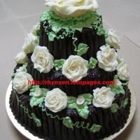 Chocolate On Chocolate On Chocolate  a choc-moist cake covered in choc ganache with white choc roses. initially wanted to make choc cigarellos, but was too lazy. so i ended up...