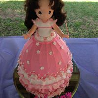 First Bitthday Doll cake, the doll belonged to her mom. Kept in storage to be used for her daughter's first birthday. Precious moment.