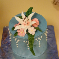 Wilton Flowers Class Cake 2 This is one of 4 mini cakes I did for my final in my Wilton flowers class. It is frosted in blue buttercream. The Lily and rose are royal...