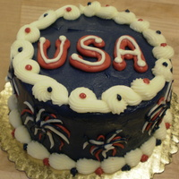 "Usa - Fireworks 6"" Yellow cake with buttercream fireworks."