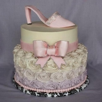 "High Heel Cake   10""/8"" iced in SMBC, with rose swirls, a gp bow and gp high heel."