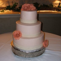 Natalie Buttercream with chocolate clay roses and ribbon.