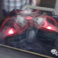 Carved Biohazard Symbol With Red Lights And Dry Ice Fog! This cake looked so wicked with the red lights and fog. I couldn't believe it! It was made from 3 ten inch round cakes put together...
