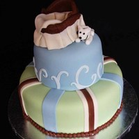 Baby Shower Blue, Green And Brown The mom to be loves her little dog so I had to include him next to the bassinet. :)