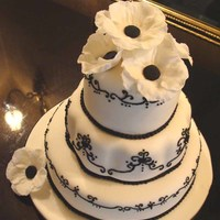 Black And White   Anemonies made of fondant crown this wedding cake