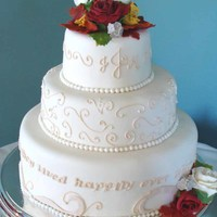 Happily Ever After Cake Fondant flowers and a message wishing them to live 'Happily Ever After' adorn this elegant cake