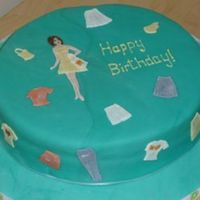 Fashion Girl!   Covered in fondant. Used patchwork cutters with fondant for girl and clothing.