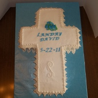 Cross butter cream with fondant lace and flowers