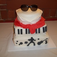 Elvis all fondant and gum paste. the glasses are real