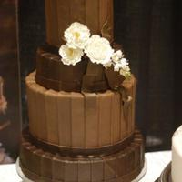 "Pleated Chocolate 12';10;8;6. Darker colored tiers were 3"" high, lighter colored tiers were 6"" high. All chocolate fondant with gumpaste..."