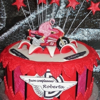 Ducati Motorbike Cake Rich chocolate cake with chocolate cream layers with gumpaste Ducati motorbike.