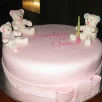 Amelias1St Birthday Girls ist birthday cakes. Mud cake ,eddible bears and fondant ribbon and bow