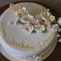 Dianne's Cake White chocolate Mud cake with white chocolate fondant and roses