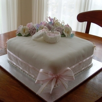 Engagement Cake This is an engagement cake I did for my niece.White chocolate mud with sugar flowers,sugar ring box