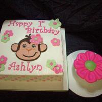 Ashlyn's First B-Day Simple square cake with fonant cut out of girl monkey and simple cutout flowers. The smash cake was a six inch that has a buttercream pink...
