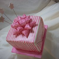 Practice Cake & Dtc Tutorial I did this practice cake when I wrote the tutorial for the gum paste package bow for the DTC blog. The cake is covered in fondant and the...
