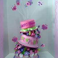 "Butterflies And Flowers Baby Shower A Whimsical / Topsy-Turvy Cake made to match with a baby shower decoration. First time have been used the cake stand and the ""Cricut..."