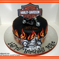 Harley Davidson A 10x3-inch round cake covered with Satin Ice rolled fondant. Flames, logo and script were made in a 50/50 gum paste and fondant, with some...