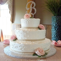 Mixed Design Wedding Cake With Ribbon And Fresh Roses   Mixed design wedding cake with ribbon and fresh roses