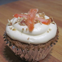 Carrot Cupcake Homemade carrot cupcake with cream cheese icing topped with pecans and candied carrots. Candied carrots actually turned out good!! thanks...
