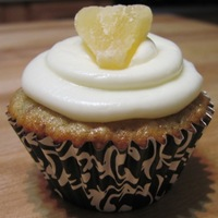 Pina Colada Cupcake Made these for my dad's birthday! Homemade pineapple/rum extract/pecan cupcake with cream cheese/rum extract icing and topped with a...