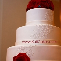 Red White And Blue Chocolate roses, sugar blue diamonds, piped royal icing to match the bride's lace dress and fondant ribbons work together to bring...