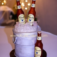 Pail Of Beer Sugar bottles, ice and some chocolate cake make up this fun groom's cake.