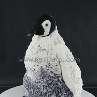 King Emperor Penguin Chick 100% edible King Emperor Penguin Chick. Alternating layers of peanut butter and chocolate peanut butter cake with peanut butter filling.