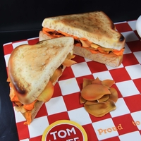 Tom + Chee Grilled cheese cakes for celebrating a company's second anniversary. The first one is one of their award winning sandwiches--cheese,...
