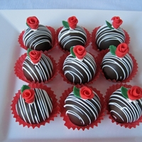 Rosebud Cake Balls Chocolate hazelnut cake balls dipped in dark chocolate and topped with fondant rosebud and leaf.