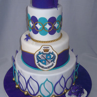 Tcu Graduation Including Hand Modeled Horned Frog And Edible Zta Crest Bottom Tier Petals Created Using Stephen Benison Cutter   TCU graduation including hand-modeled horned frog and edible ZTA crest. Bottom tier petals created using Stephen Benison cutter.