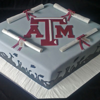 Texas A&m Diplomas 19x14 diamond shaped cake topped with personalized, 100% edible diplomas that can be unrolled and eaten! Hand cut fondant silhouettes.
