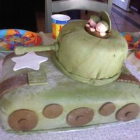 Army Tank This was for my nephew's 8th birthday. It is chocolate fudge cake with a chocolate peanut butter frosting, covered and decorated in...