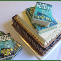 Tony Groom's cake representing groom's favorite author. Chocolate cake on bottom. Other layers/books strawberry cake. Edible images...