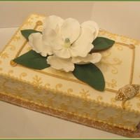 Magnolia Cake This is a 12 x 18 double layer cake. I made the magnolia using Minette Rushing's youtube instructions. (Although I had to cut my...