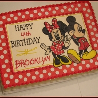 Mickey And Minnie Made for a friend's granddaughter. Buttercream with fondant polka dots border. Based on an invitation.