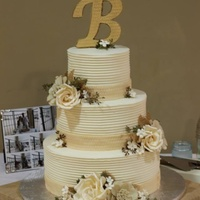 Rustic Elegance 12, 9, 6 round cakes with combed buttercream, sugarpaste roses and filler flowers, and burlap fantasy flowers and leaves. The initial is...